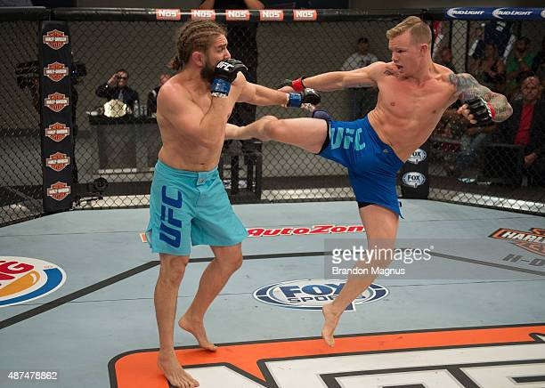 Austin Springer kicks Chris Gruetzemacher during the elimination fights at the UFC TUF Gym on July 17 2015 in Las Vegas Nevada