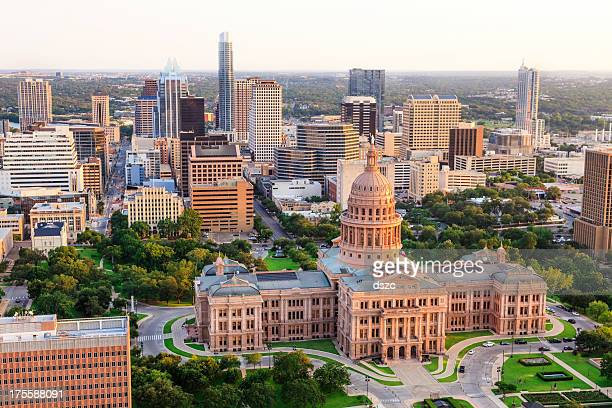 Austin Texas Capitol building sunset aerial with downtown skyline background