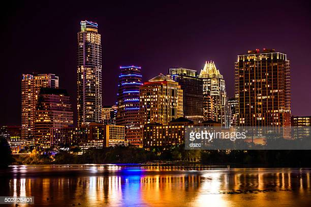 Austin, Texas skyline cityscape skyscrapers over Ladybird Lake at night
