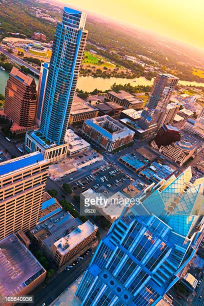 Austin Texas skyscrapers aerial skyline at sunset from helicopter