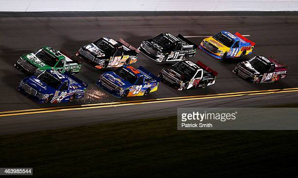 Austin Theriault driver of the Cooper Standard Careers for Veterans Ford and Johnny Sauter driver of the Smokey Mountain/Curb Records Toyota lead a...