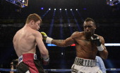 Austin Trout punches Canelo Alvarez of Mexico during the WBC WBA and Vacant Ring Magazine Super Welterweight Title Fight at Alamodome on April 20...