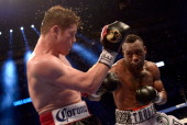 Austin Trout punches Canelo Alvarez of Mexico en route to Alvarez's unanimous 12round decision over Trout during the WBC WBA and Vacant Ring Magazine...