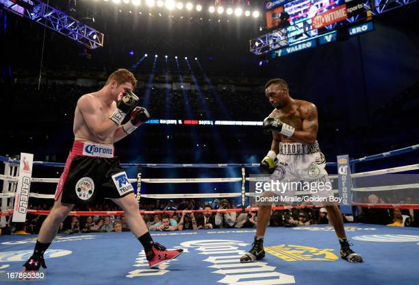 Austin Trout squares up with Canelo Alvarez of Mexico during the WBC WBA and Vacant Ring Magazine Super Welterweight Title Fight at Alamodome on...