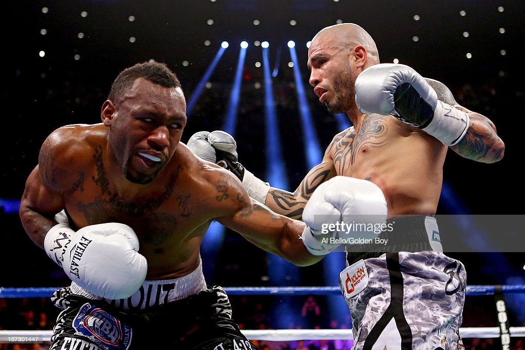 Austin Trout (L) trades punches with <a gi-track='captionPersonalityLinkClicked' href=/galleries/search?phrase=Miguel+Cotto&family=editorial&specificpeople=4329258 ng-click='$event.stopPropagation()'>Miguel Cotto</a> in their WBA Super Welterweight Championship title fight at Madison Square Garden on December 1, 2012 in New York City.