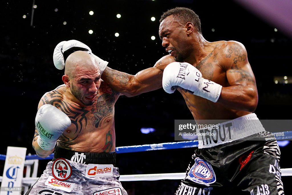 Austin Trout (R) trades punches with <a gi-track='captionPersonalityLinkClicked' href=/galleries/search?phrase=Miguel+Cotto&family=editorial&specificpeople=4329258 ng-click='$event.stopPropagation()'>Miguel Cotto</a> in their WBA Super Welterweight Championship title fight at Madison Square Garden on December 1, 2012 in New York City.