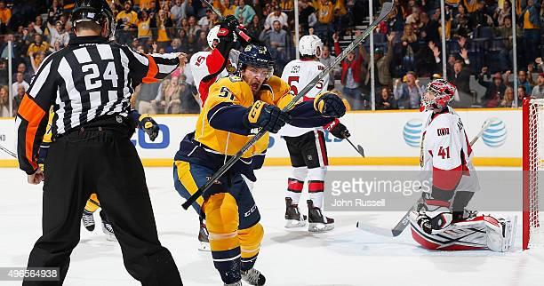 Austin Watson of the Nashville Predators celebrates his goal against Craig Anderson of the Ottawa Senators during an NHL game at Bridgestone Arena on...