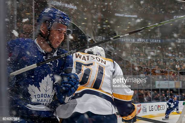 Austin Watson of the Nashville Predators checks Connor Brown of the Toronto Maple Leafs during the third period at the Air Canada Centre on November...