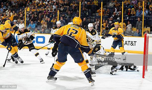 Austin Watson of the Nashville Predators scores against Zane McIntyre of the Boston Bruins during an NHL game at Bridgestone Arena on January 12 2017...