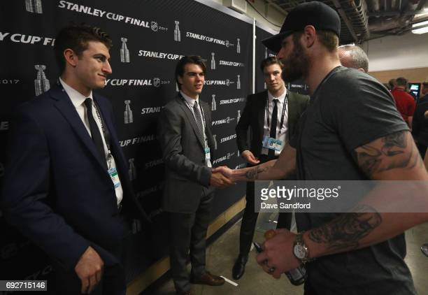 Austin Watson of the Nashville Predators shakes hands with top prospects Nico Hischier and Gabriel Vilardi during media availability for 2017 NHL...