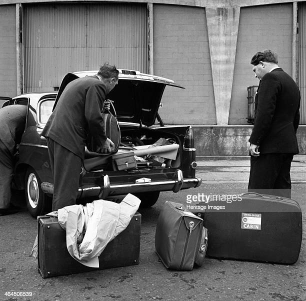 Austin Westminster being loaded with luggage on Amsterdam docks Netherlands 1963