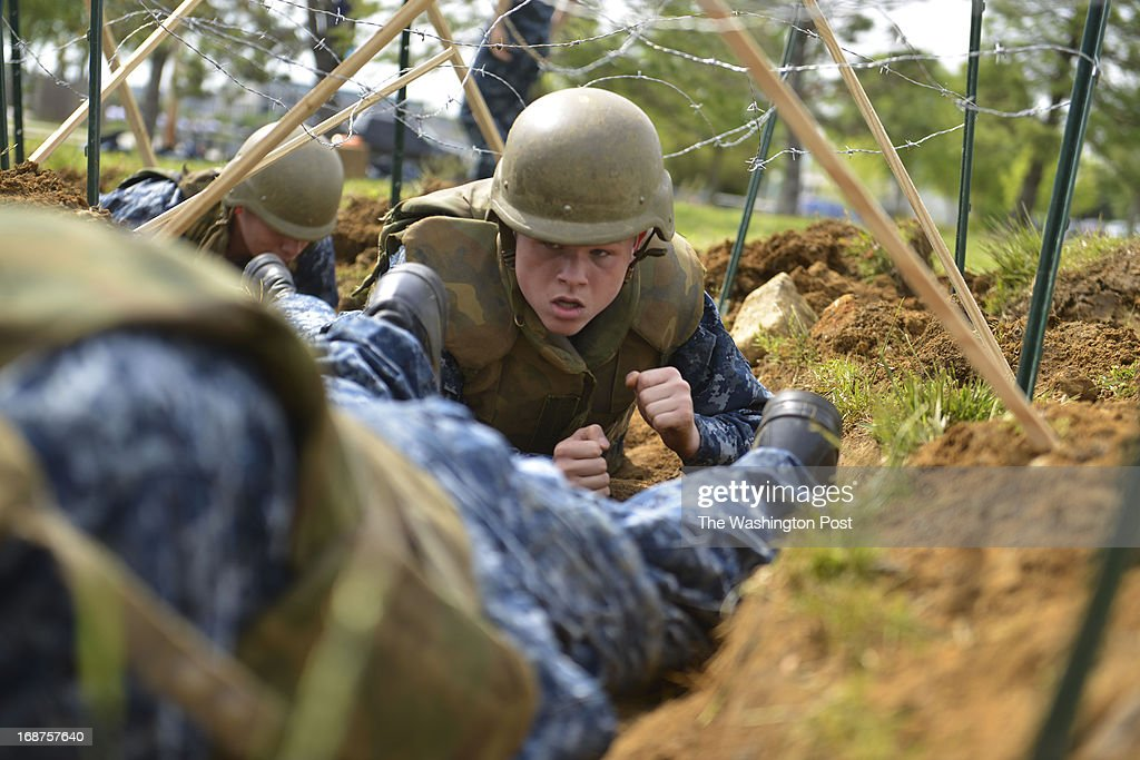 "MAY 14 Austin Whitehead and his fellow midshipmen crawl through makeshift trenches during their sea trials at the United States Naval Academy in Annapolis, Maryland on May 14, 2013. Sea Trials is modeled after the Marine Corps' Crucible and the Navy's Battle Stations recruit programs. It is a ""capstone"" event for the fourth class midshipmen (freshmen or ""plebes"") and serves as a leadership challenge for the upper class. Sea Trials is led by academy upper class and provides a final physical and mental challenge to the plebes, designed to test their teamwork and to reinforce their bonds as a company and class. Plebes are physically and mentally tested through a variety of challenges in different stations located across the Academy and Naval Support Activity Annapolis. At the end of Sea Trials, the company of plebes who demonstrated the top unit performance through endurance and spirit during the entire course will be recognized with the ""Iron Company"" award during a brief presentation."