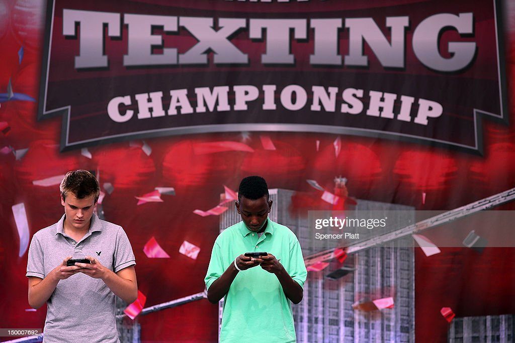 Austin Wierschke (left) and Kent Augustine compete in the final round of the Sixth Annual LG Mobile U.S. National Texting Championships on August 8, 2012 in New York City. This years winner was again Austin Wierschke who took home $50,000.