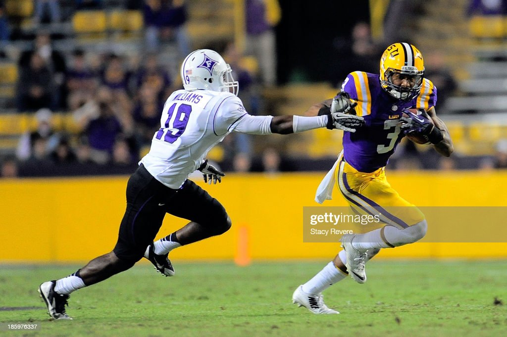 Austin Williams #19 of the Furman Paladins reaches for Odell Beckham Jr. #3 of the LSU Tigers during a game at Tiger Stadium on October 26, 2013 in Baton Rouge, Louisiana. LSU won the game 48-16.