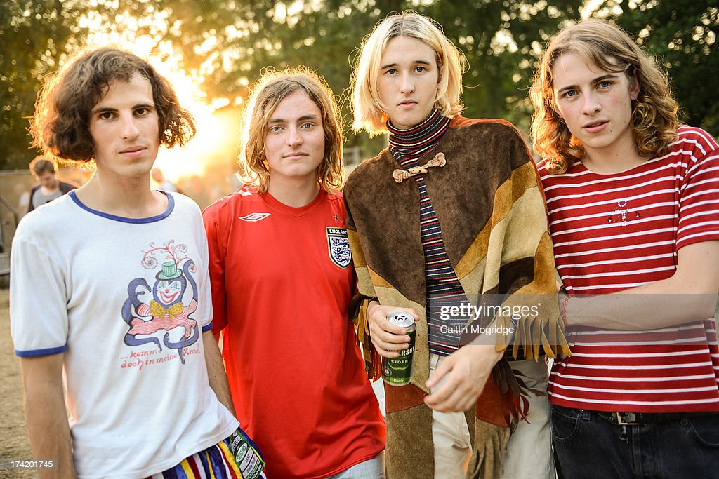 Austin Williams, Tom Higgins, Cavan McCarthy and Zach Robinson of Swim Deep pose for a photo backstage on July 19, 2013 in Southwold, England.