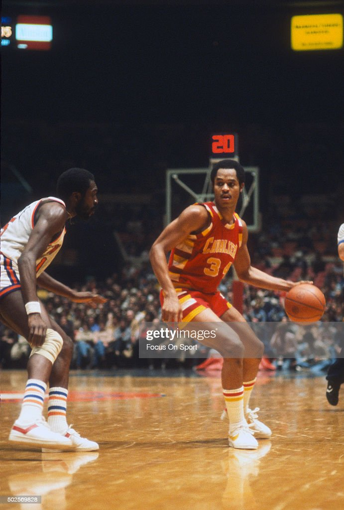 AustinCarr of the Cleveland Cavaliers dribbles the ball while defended by Earl Monroe of the New York Knicks during an NBA basketball game circa 1978...