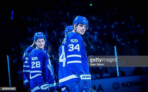 Auston Matthews and Connor Brown of the Toronto Maple Leafs stand on the ice during player introductions during opening night before play against the...
