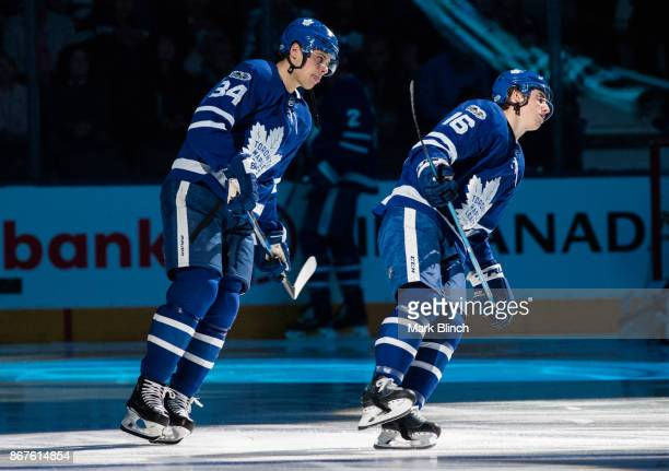 Auston Matthews and Mitch Marner of the Toronto Maple Leafs skate during warm up before playing the Philadelphia Flyers at the Air Canada Centre on...