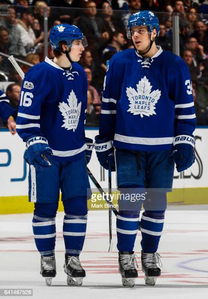 Auston Matthews and Mitch Marner of the Toronto Maple Leafs speak during a break against the Dallas Stars during the third period at the Air Canada...