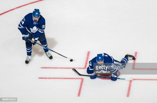 Auston Matthews and Mitch Marner of the Toronto Maple Leafs stretch during warm up prior to the game against the Boston Bruins at the Air Canada...