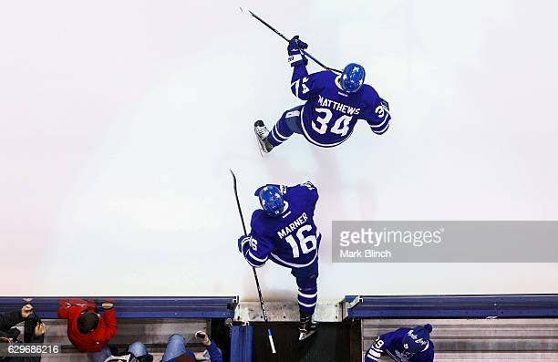 Auston Matthews and Mitch Marner of the Toronto Maple Leafs take the ice against the Colorado Avalanche during the first period at the Air Canada...