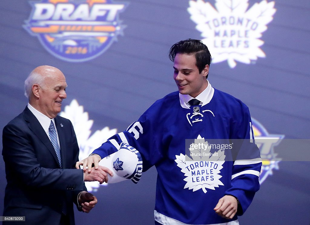 Auston Matthews celebrates onstage with the Toronto Maple Leafs after being selected first overall by the Toronto Maple Leafs during round one of the 2016 NHL Draft on June 24, 2016 in Buffalo, New York.