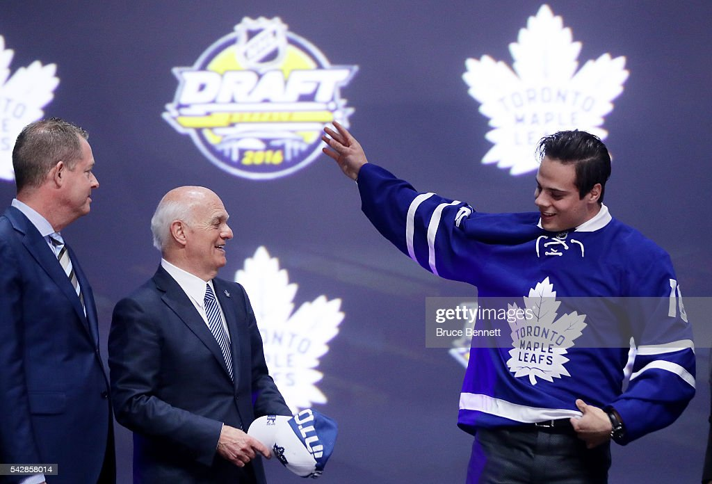 <a gi-track='captionPersonalityLinkClicked' href=/galleries/search?phrase=Auston+Matthews&family=editorial&specificpeople=13452736 ng-click='$event.stopPropagation()'>Auston Matthews</a> celebrates onstage with Toronto Maple Leafs General Manager <a gi-track='captionPersonalityLinkClicked' href=/galleries/search?phrase=Lou+Lamoriello&family=editorial&specificpeople=540467 ng-click='$event.stopPropagation()'>Lou Lamoriello</a> after being selected first overall during round one of the 2016 NHL Draft on June 24, 2016 in Buffalo, New York.