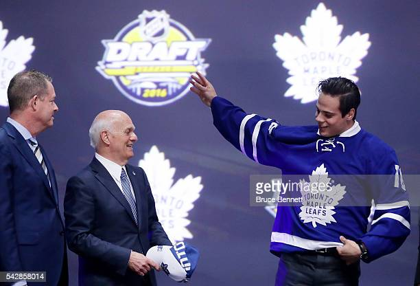 Auston Matthews celebrates onstage with Toronto Maple Leafs General Manager Lou Lamoriello after being selected first overall during round one of the...