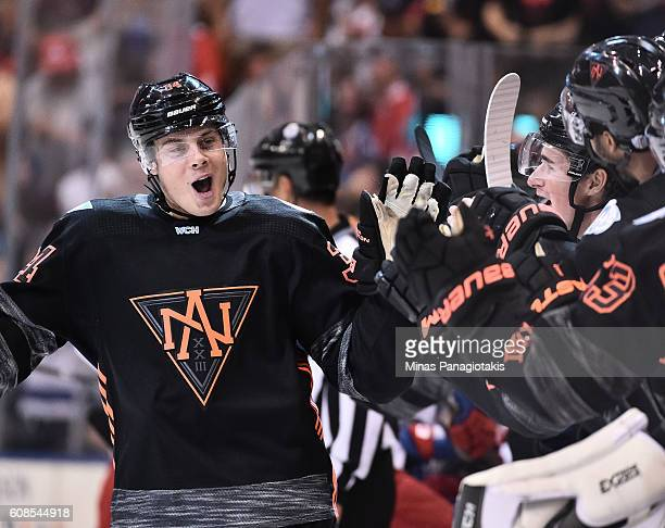 Auston Matthews of Team North America high fives the bench after scoring a first period goal on Team Russia during the World Cup of Hockey 2016 at...