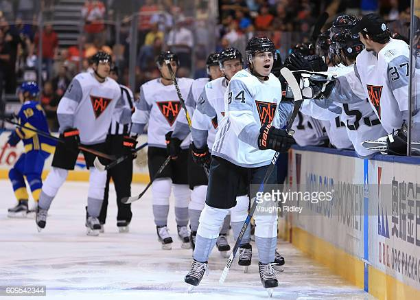 Auston Matthews of Team North America high fives the bench after scoring a first period goal on Team Sweden during the World Cup of Hockey 2016 at...