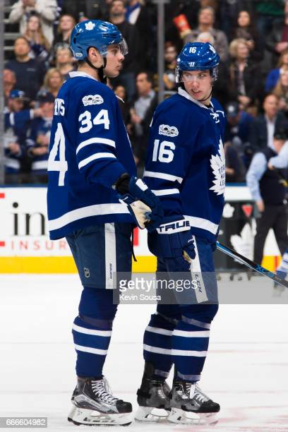 Auston Matthews of the Toronto Maple Leafs and Mitch Marner head back to the bench at an NHL game against the Pittsburgh Penguins during the second...