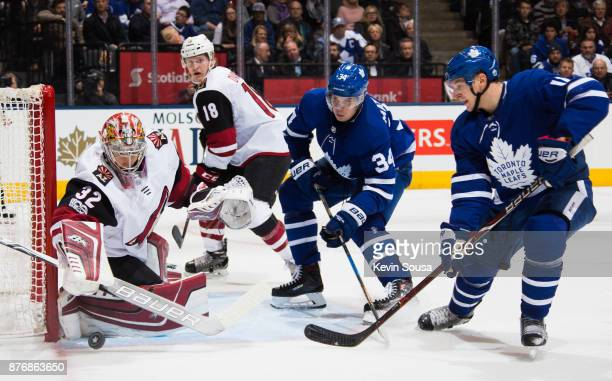 Auston Matthews of the Toronto Maple Leafs and Zach Hyman of the Toronto Maple Leafs come in on Antti Raanta of the Arizona Coyotes during the second...