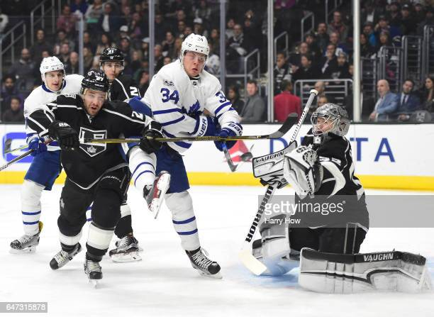 Auston Matthews of the Toronto Maple Leafs attempts a deflection on Jonathan Quick of the Los Angeles Kings as Alec Martinez defends during the first...