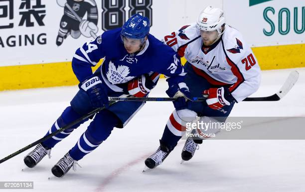 Auston Matthews of the Toronto Maple Leafs battles for position with Lars Eller of the Washington Capitals during the first period in Game Six of the...