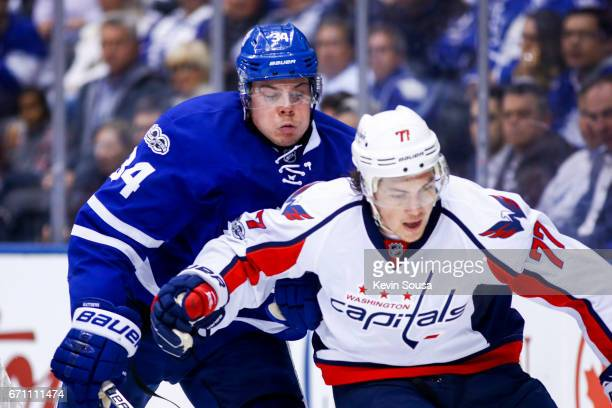 Auston Matthews of the Toronto Maple Leafs battles for the puck against the TJ Oshie of the Washington Capitals during the third period in Game Four...
