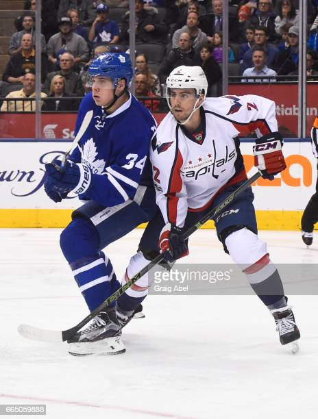 Auston Matthews of the Toronto Maple Leafs battles with Matt Niskanen of the Washington Capitals during the third period at the Air Canada Centre on...