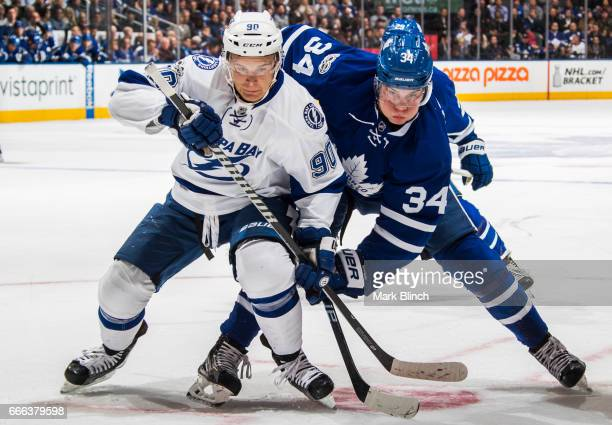 Auston Matthews of the Toronto Maple Leafs battles with Vladislav Namestnikov of the Tampa Bay Lightning during the first period at the Air Canada...