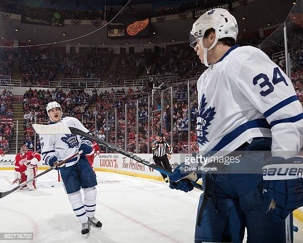 Auston Matthews of the Toronto Maple Leafs celebrates his first period goal with teammate Zach Hyman in the view of goaltender Petr Mrazek of the...