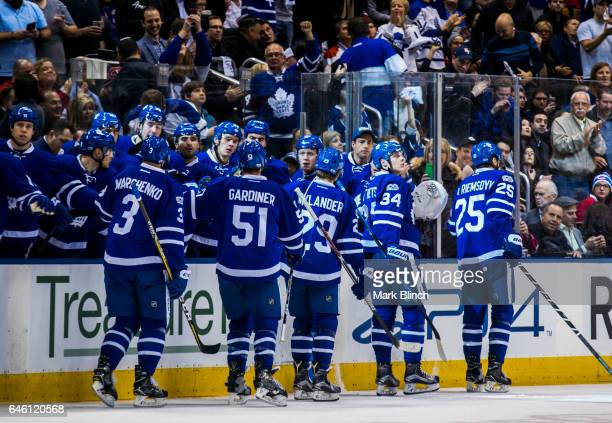 Auston Matthews of the Toronto Maple Leafs celebrates his goal with teammates James van Riemsdyk William Nylander Jake Gardiner and Alexey Marchenko...