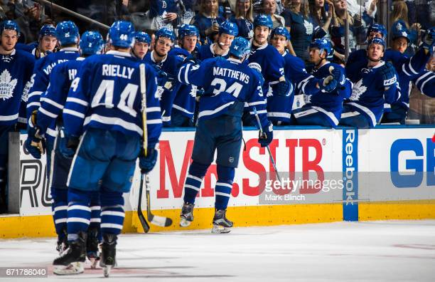 Auston Matthews of the Toronto Maple Leafs celebrates his goal with the bench against the Washington Capitals during the third period in Game Four of...