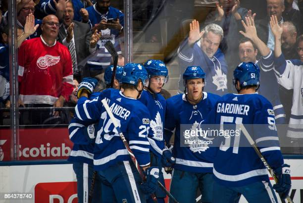 Auston Matthews of the Toronto Maple Leafs celebrates his goal with teammates Jake Gardiner Nikita Zaitsev William Nylander and Zach Hyman against...