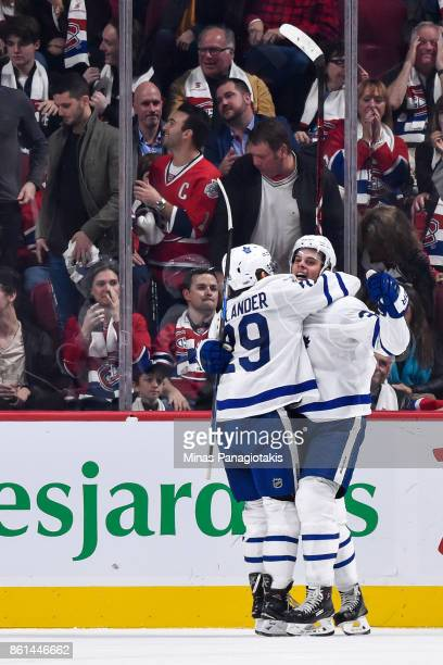 Auston Matthews of the Toronto Maple Leafs celebrates his overtime goal with teammate William Nylander against the Montreal Canadiens during the NHL...