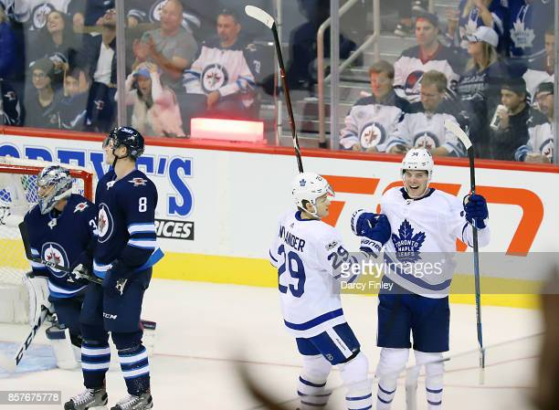 Auston Matthews of the Toronto Maple Leafs celebrates his third period goal against the Winnipeg Jets with teammate William Nylander at the Bell MTS...