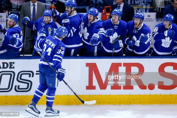 Auston Matthews of the Toronto Maple Leafs celebrates scoring against the Washington Capitals with teammates during the third period in Game Six of...