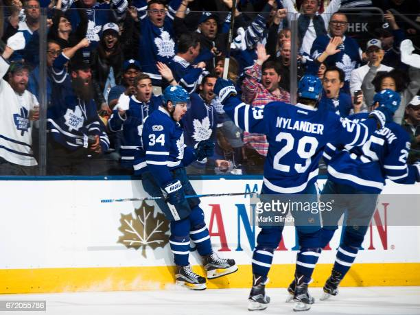 Auston Matthews of the Toronto Maple Leafs celebrates with teammates William Nylander and James van Riemsdyk after scoring on the Washington Capitals...