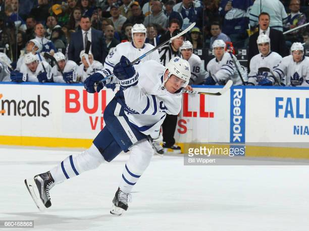 Auston Matthews of the Toronto Maple Leafs follows through on a shot against the Buffalo Sabres during an NHL game at the KeyBank Center on March 25...