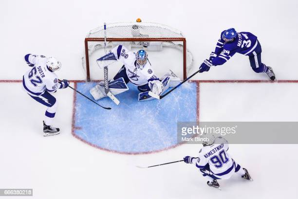 Auston Matthews of the Toronto Maple Leafs goes to the net against Andrei Vasilevskiy Andrej Sustr and Vladislav Namestnikov of the Tampa Bay...