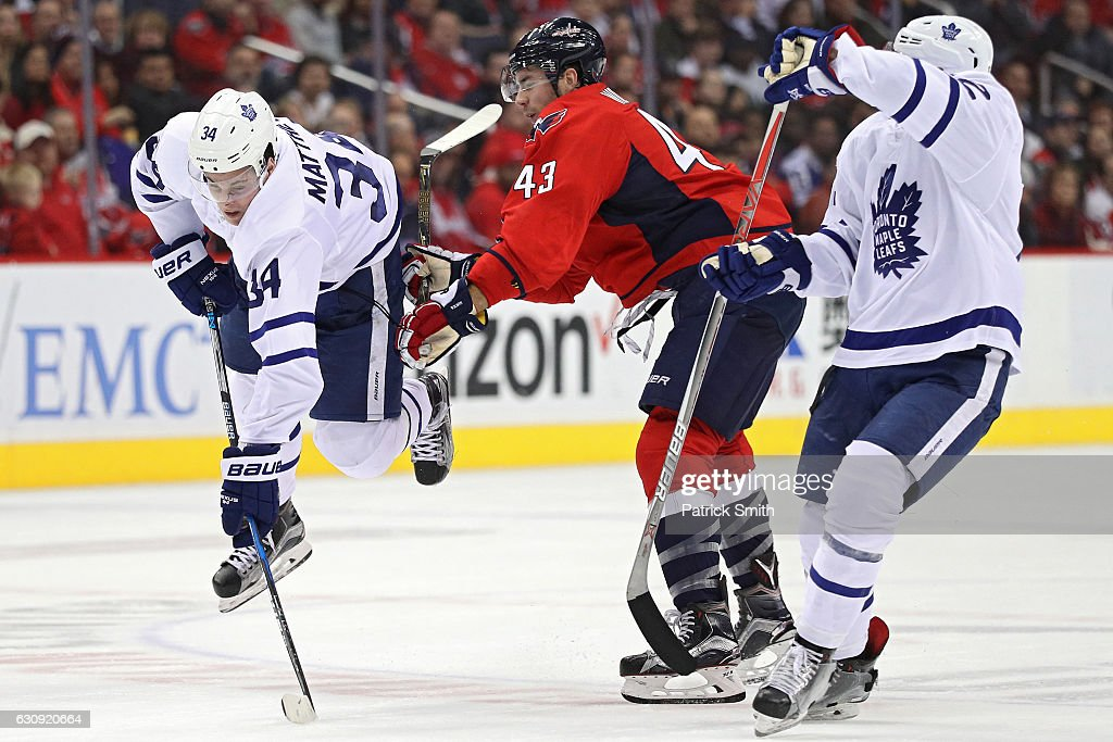 Auston Matthews #34 of the Toronto Maple Leafs is checked by Tom Wilson #43 of the Washington Capitals during the second period at Verizon Center on January 3, 2017 in Washington, DC.