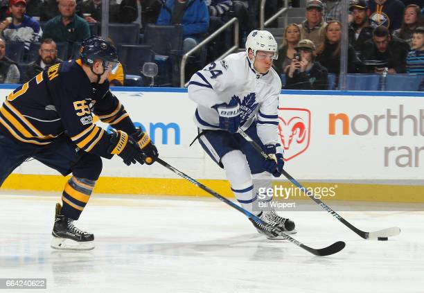 Auston Matthews of the Toronto Maple Leafs is defended by Rasmus Ristolainen of the Buffalo Sabres during an NHL game at the KeyBank Center on April...