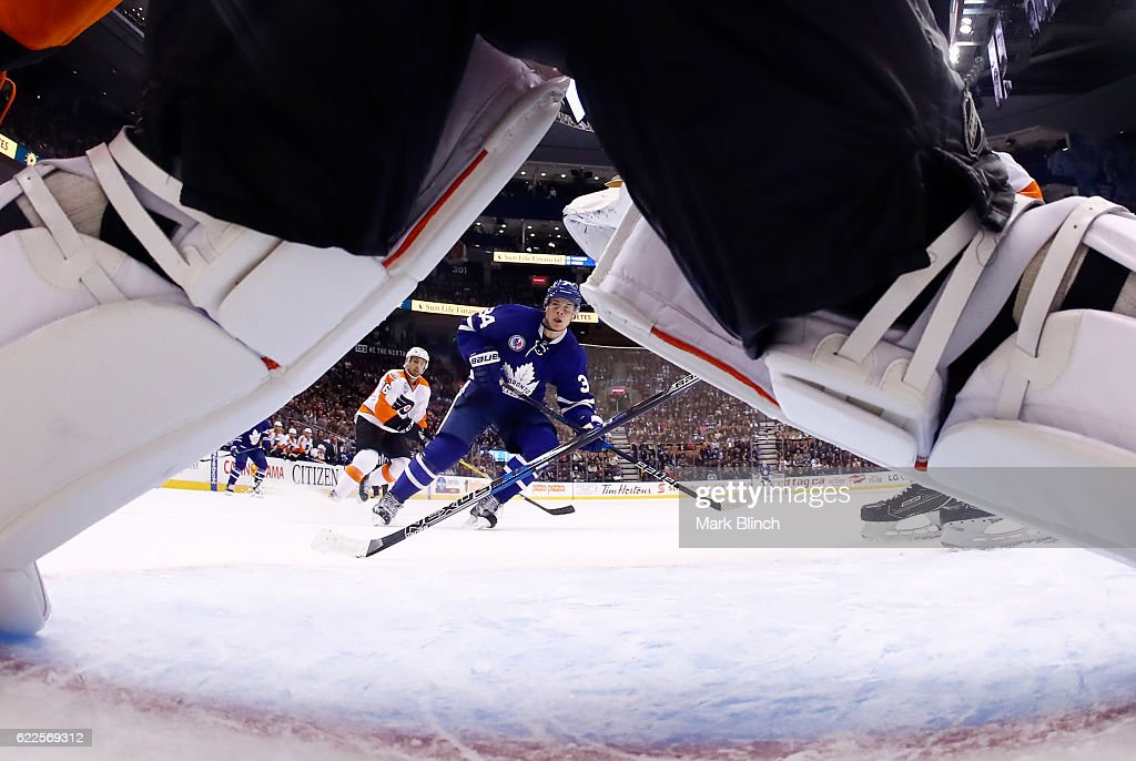 Auston Matthews #34 of the Toronto Maple Leafs is seen through the legs of Steve Mason #35 of the Philadelphia Flyers during the third period at the Air Canada Centre on November 11, 2016 in Toronto, Ontario, Canada.